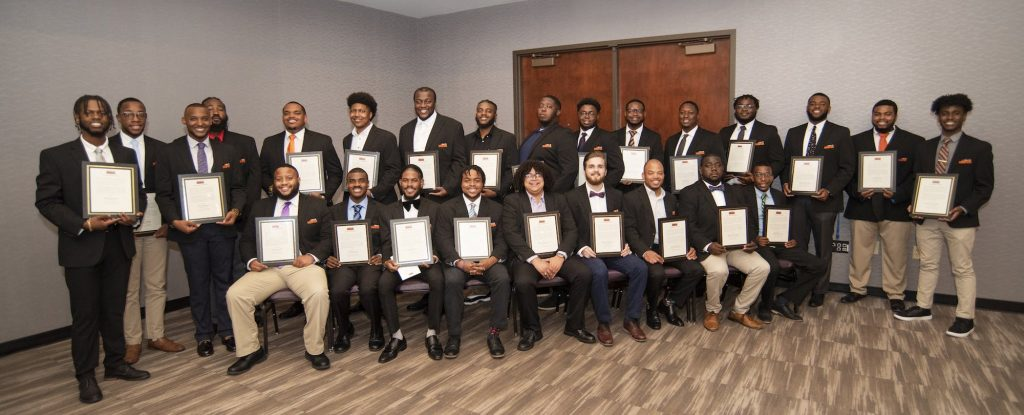 A group of black male graduates -- photo by Patrick Wright, Clemson University, Photographic Services-University Relations.